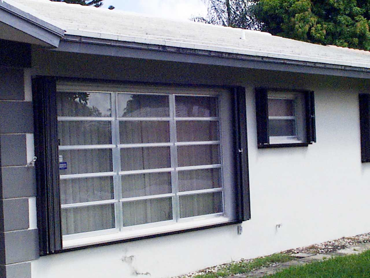 window shutters cost living room window accordion shutters hurricane shutter types