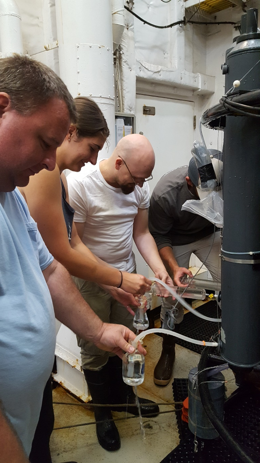 From left to right, Chuck, Leah, CFCs Chuck, and Ian working in close quarters to get their water samples