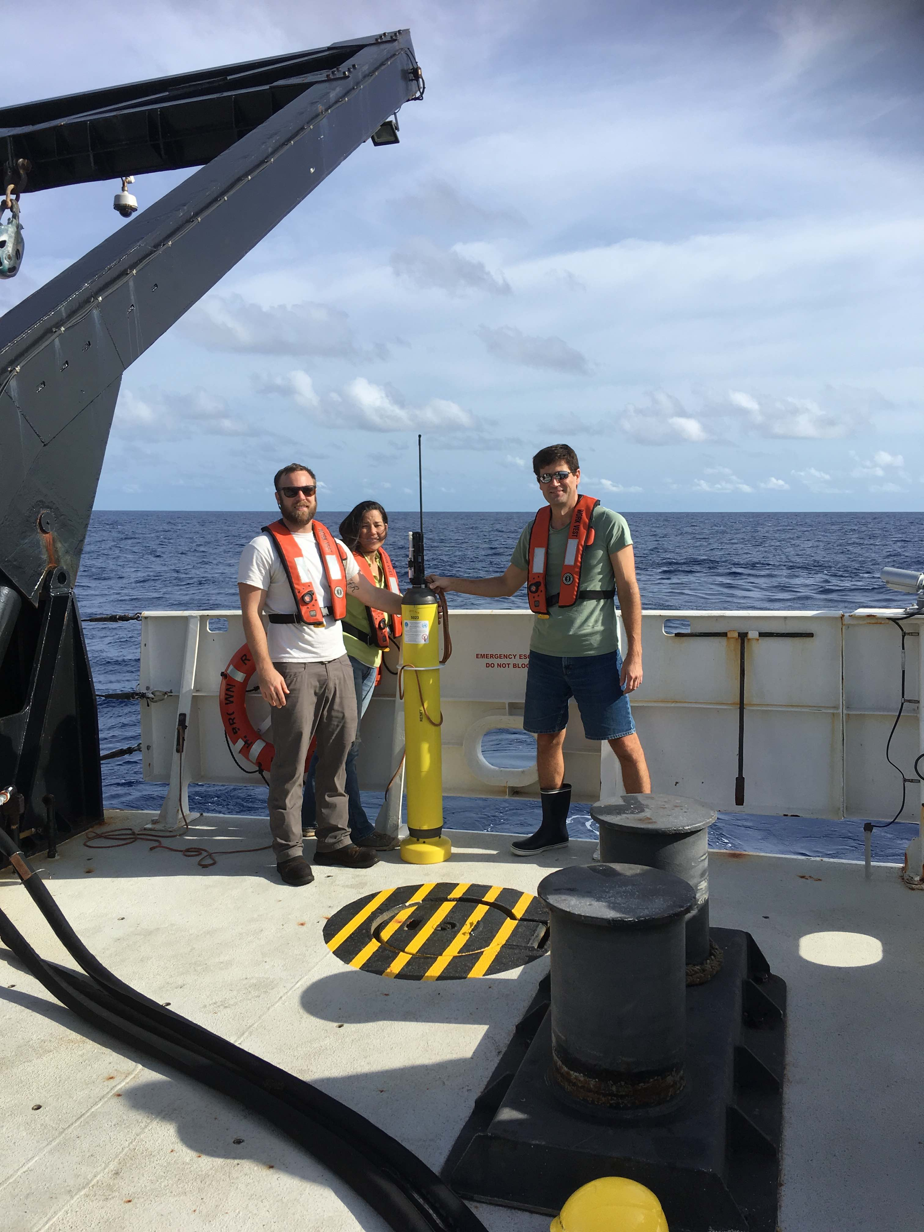 Jay, Kristy, and Denis are deploying an APEX Argo float from the NOAA Ship