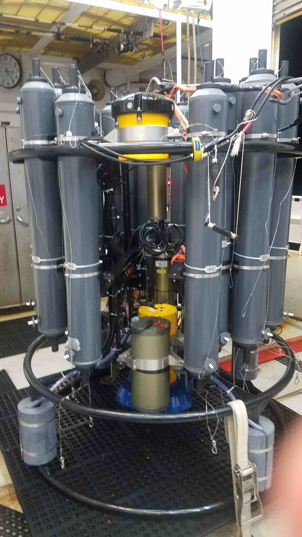 A full view of instruments attached to the platform. The LADCPs are the yellow instruments and the battery pack is the large cylinder sitting in front of the downlooker LADCP.