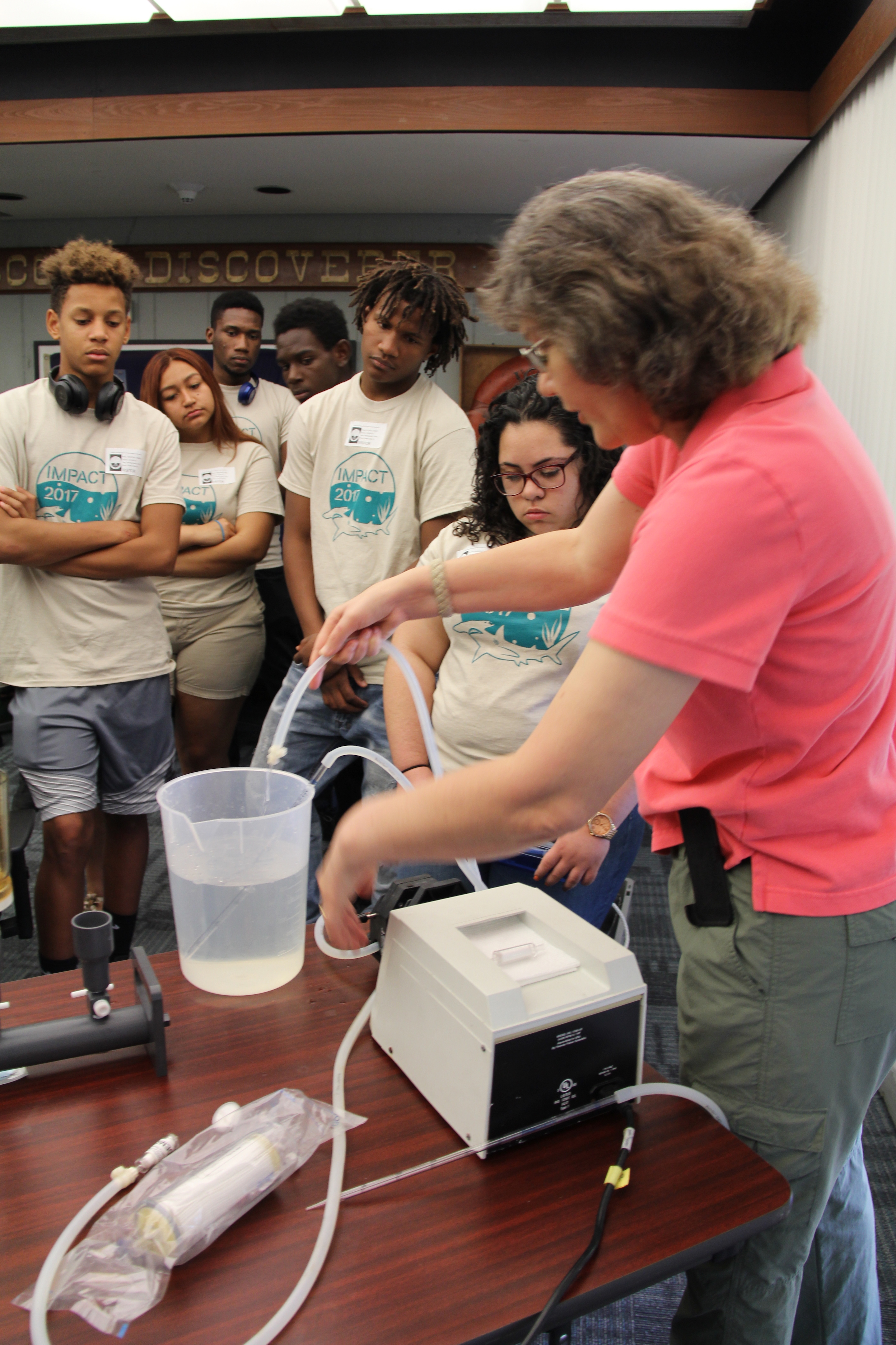 Maribeth Gidley teaches students about marine microbial ecology. Image credit: NOAA