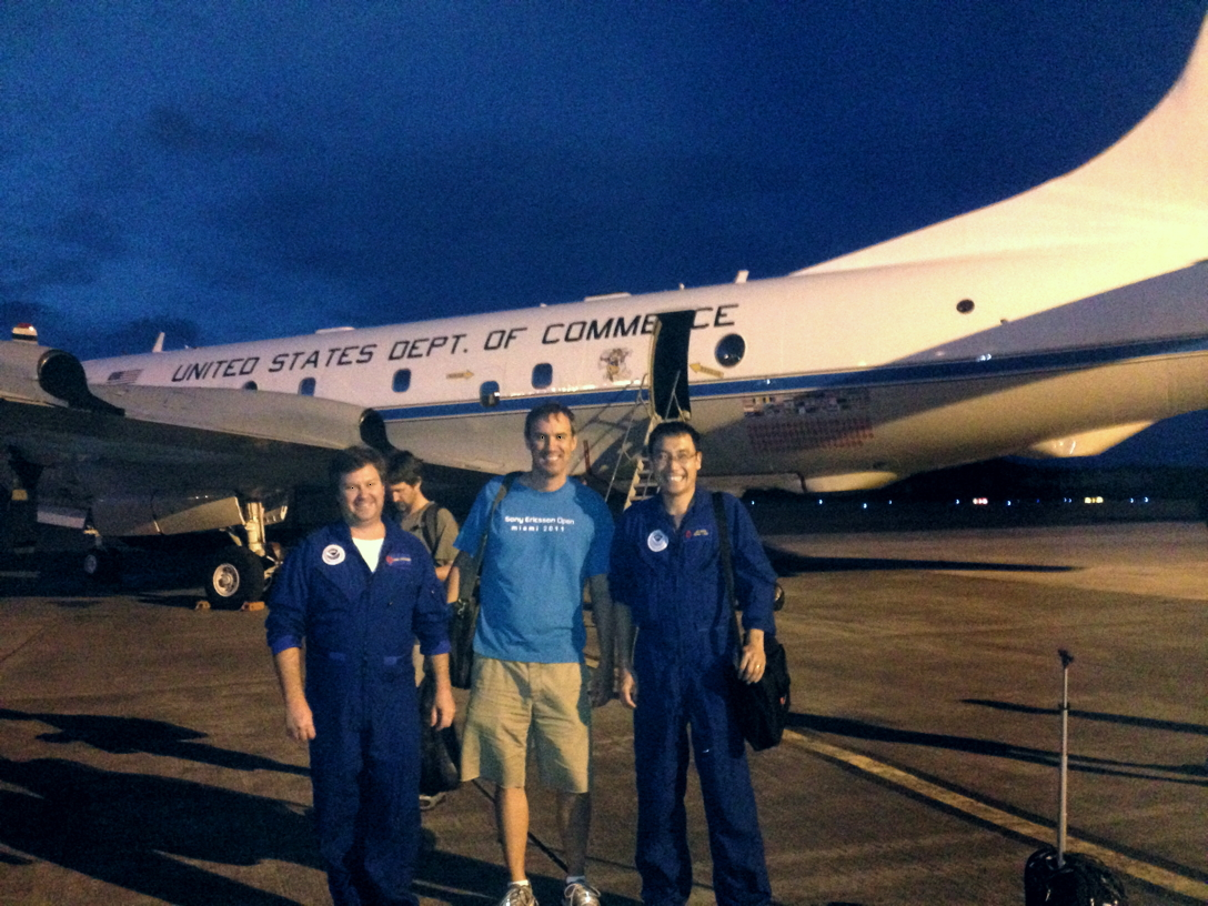 Scientists enjoy returning from their Hurricane Hunter flight. Image Credit: NOAA