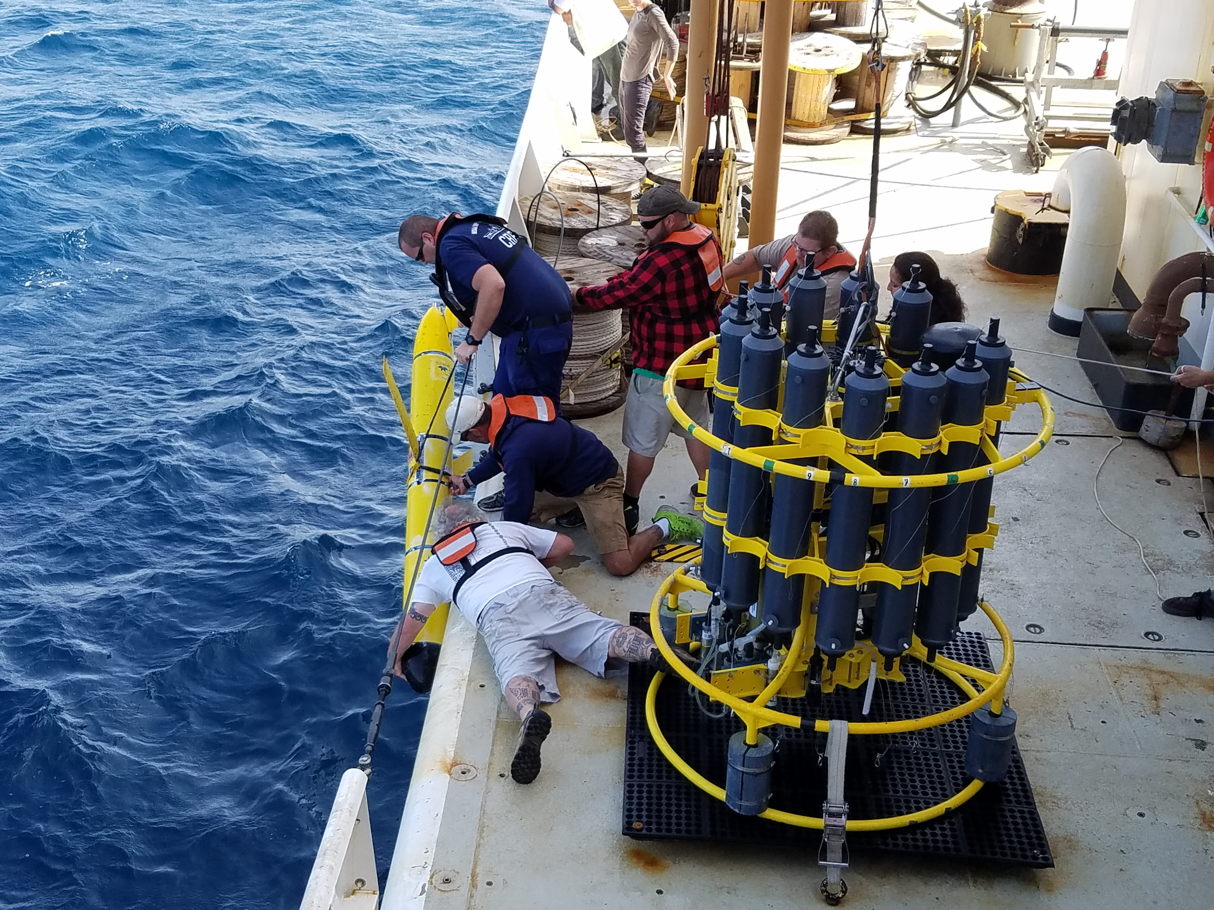 Scientists and crew members recovering an underwater glider. Image credit: NOAA