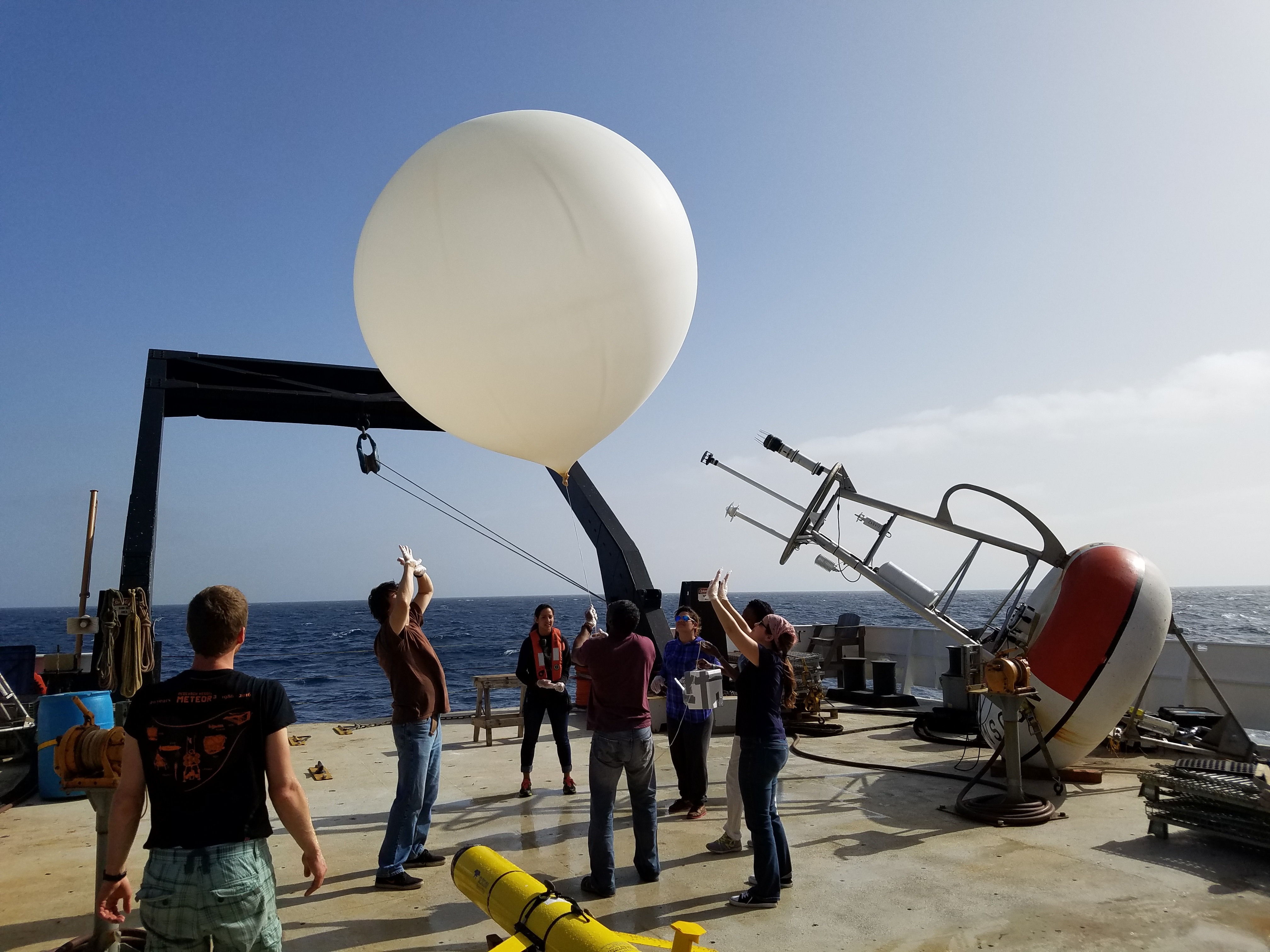 Many scientists are needed to launch an ozonesonde. Image credit: NOAA