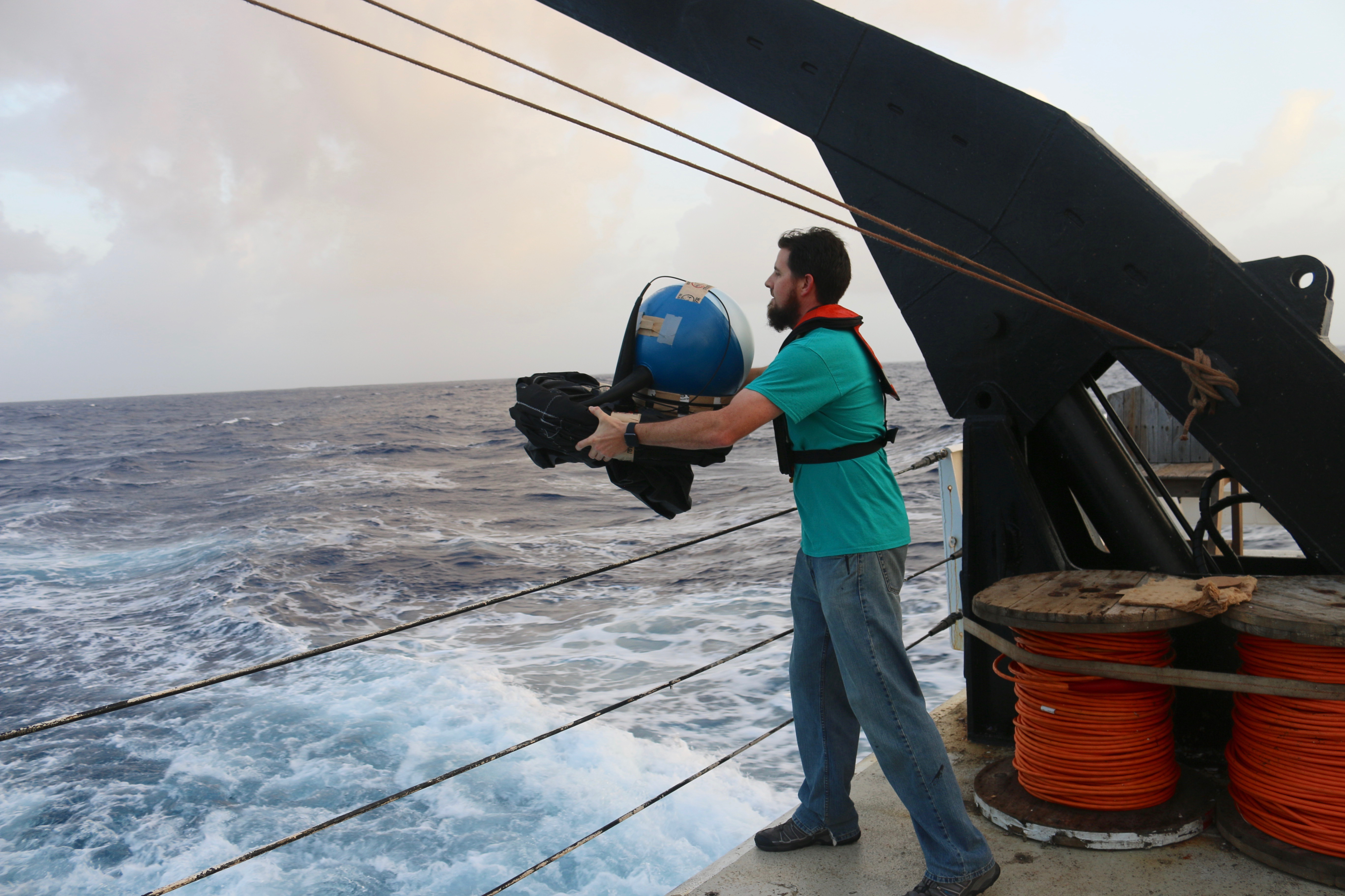 Scientist deploying a surface drifting buoy. Image credit: NOAA