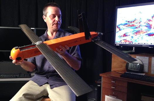 Dr. Joe Cione of AOML's Hurricane Research Division displays the Coyote UAV