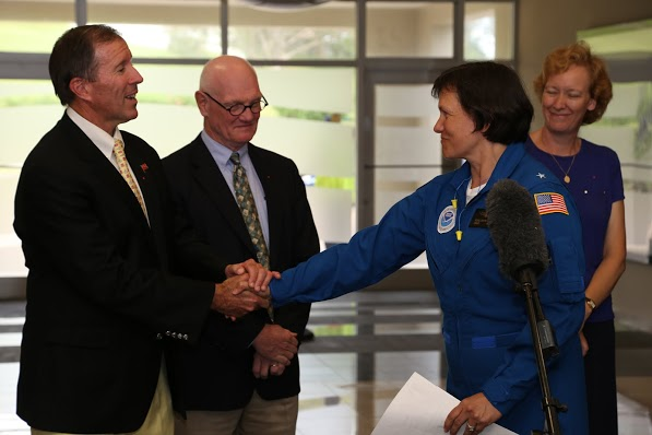 Rear Admiral Anita Lopez shakes hands with Bermuda Premier Michael Dunkley. Image credit: NOAA