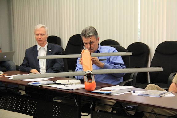 Craig McLean, NOAA's Deputy Assistant Administrator for Programs and Administration, examines the Coyote Unmanned Aerial System as AOML's Director Dr. Robert Atlas looks on. Image credit: NOAA