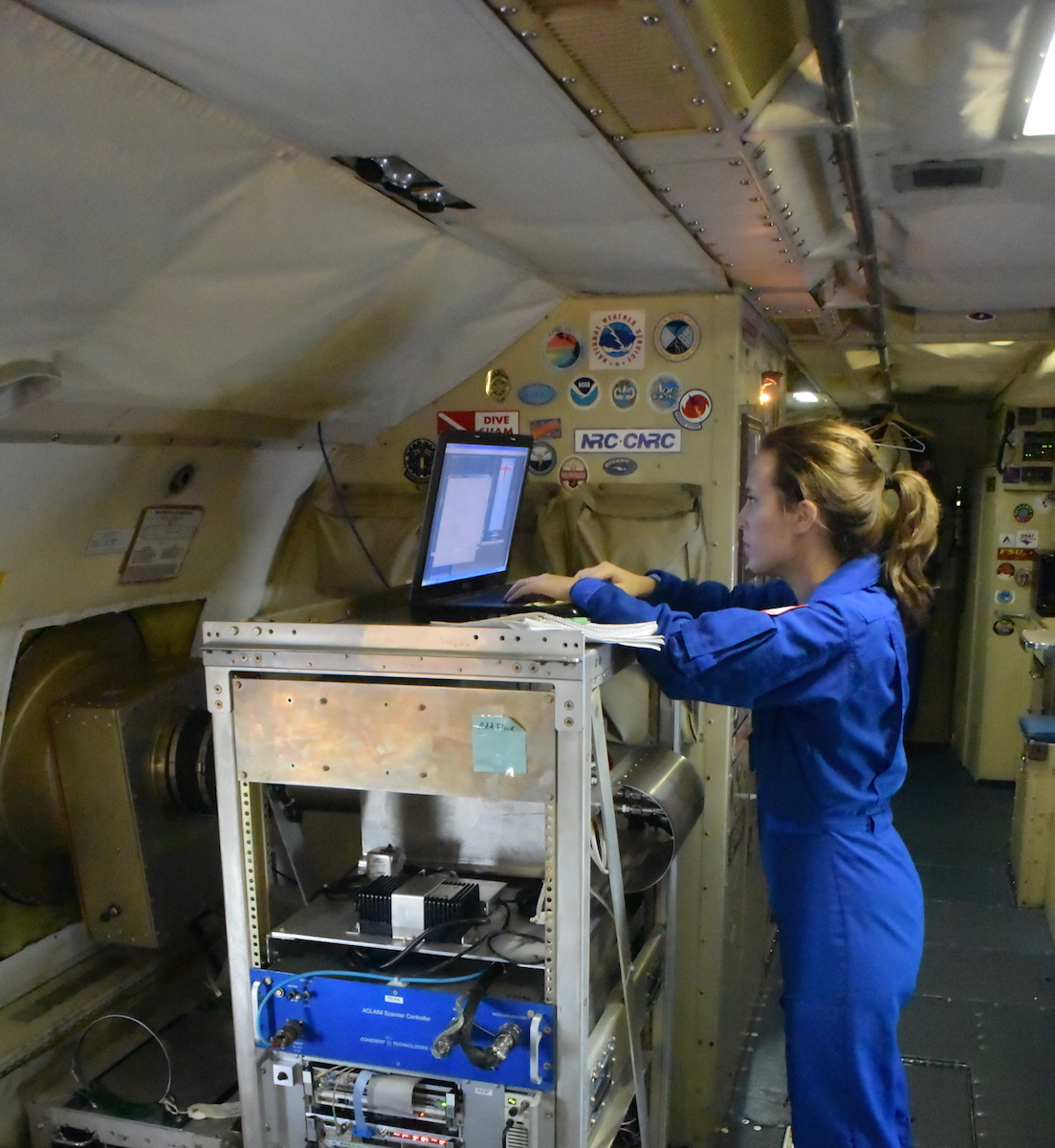 Hurricane researcher Lisa Bucci analyzing storm data aboard the P-3 aircraft. Image credit: NOAA