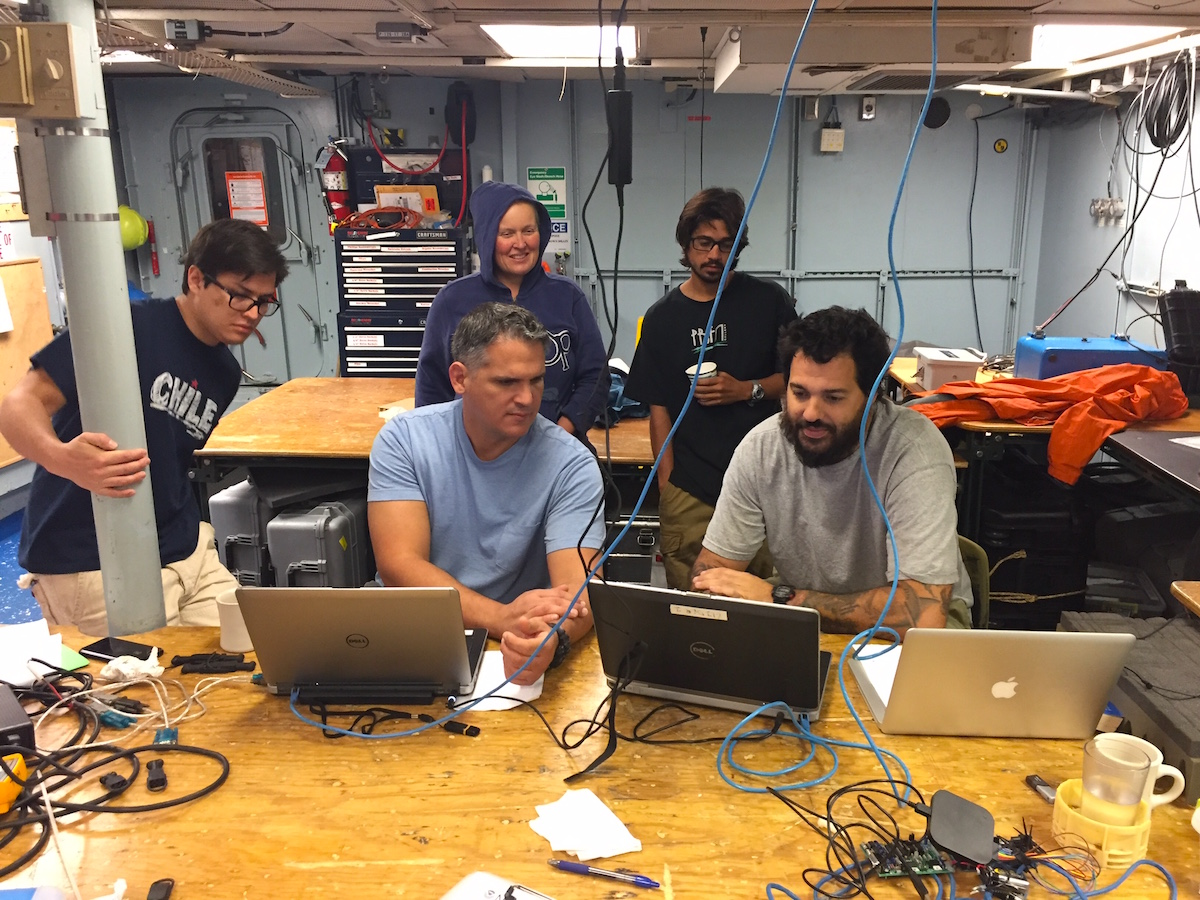 AOML and University of Puerto Rico scientists reviewing the latest ocean observations from the WBTS cruise. Image credit: NOAA