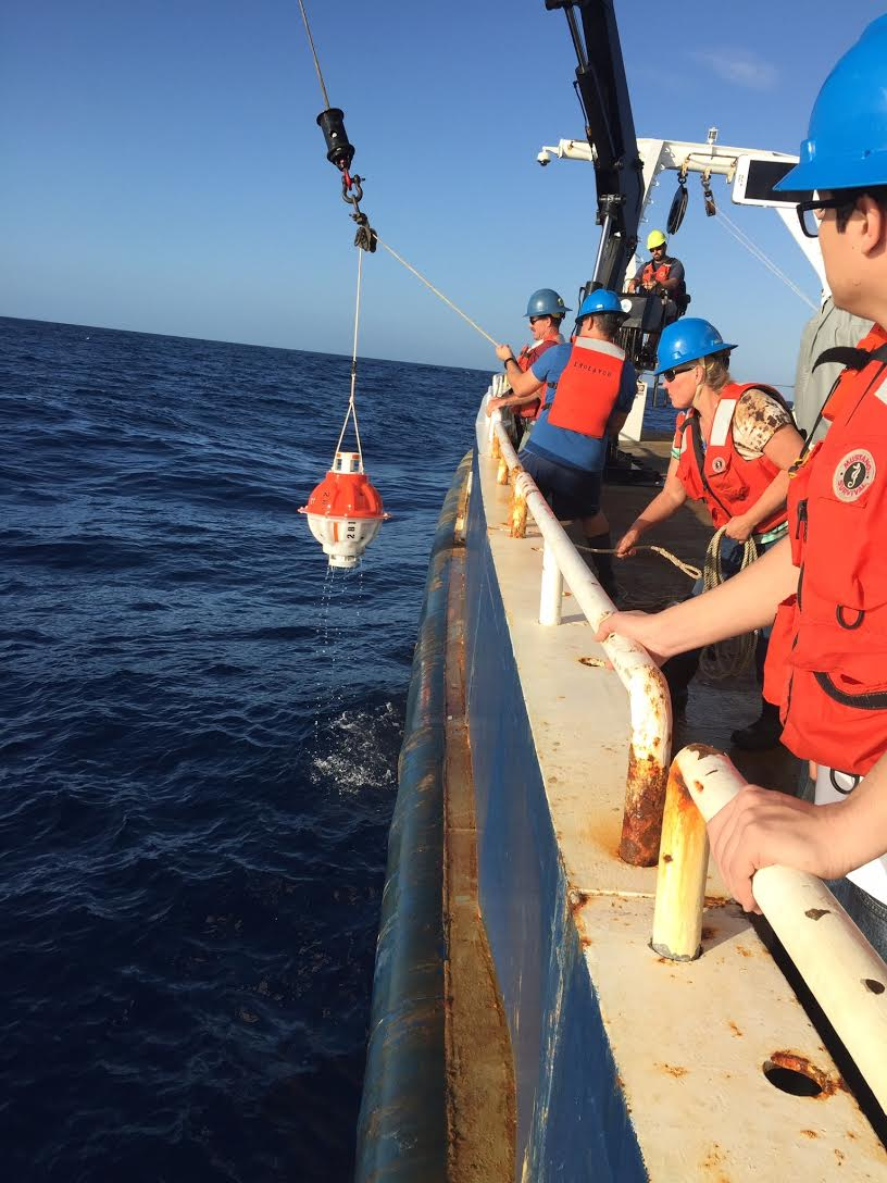Crewmembers deploy a pressure inverted echo sounder instrument to measure average sound speed in the water column. Image credit: NOAA