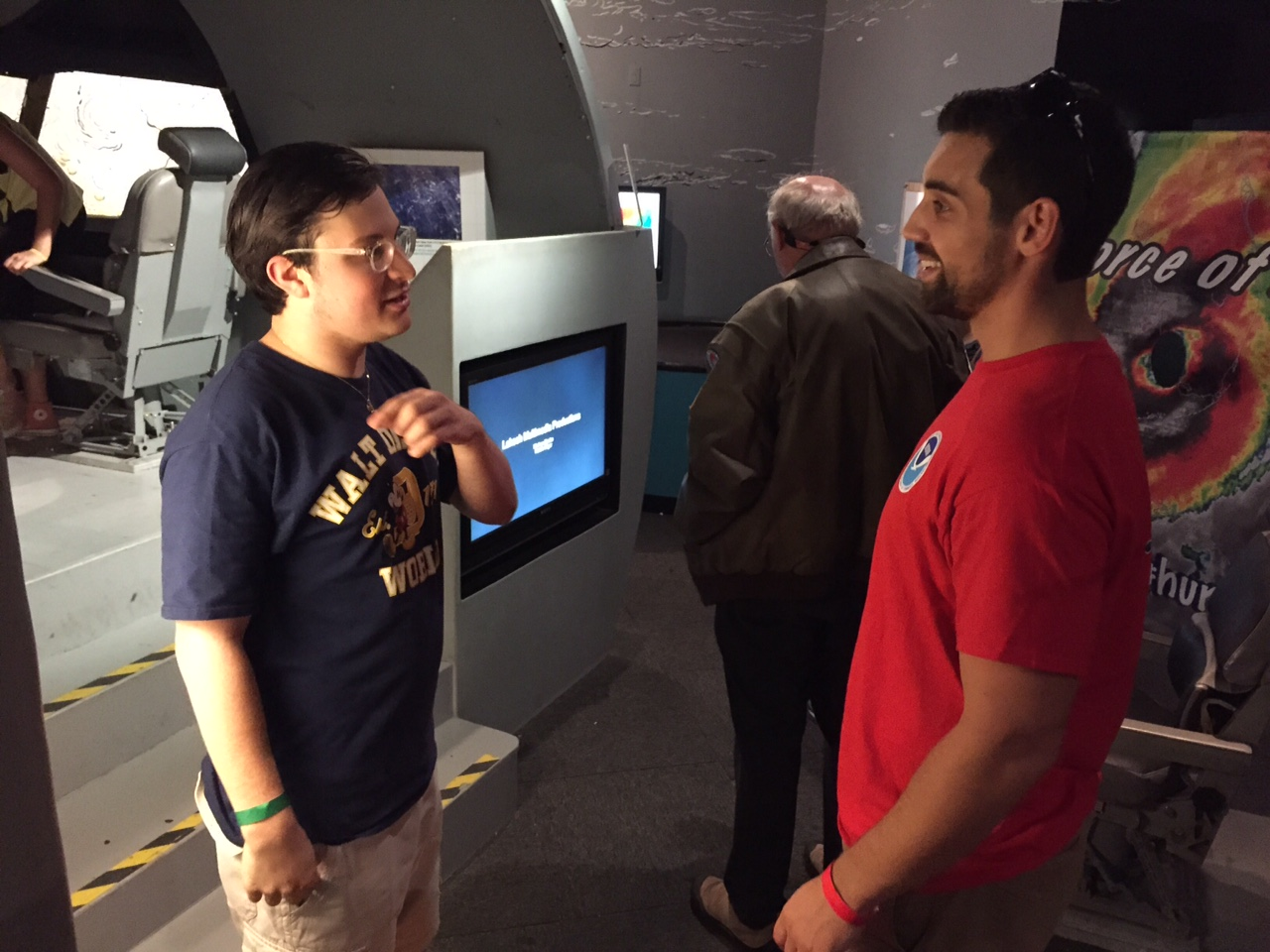 AOML hurricane researcher talks with a museum visitor. Image credit: NOAA