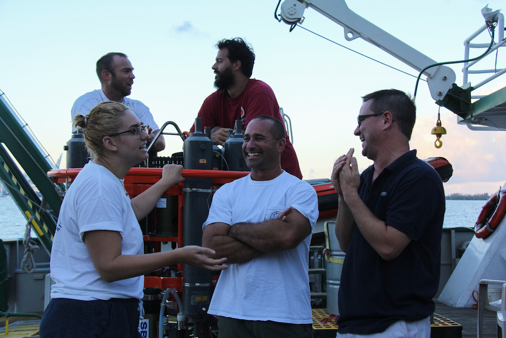 Scientists sharing a laugh aboard the ship. Image credit: NOAA