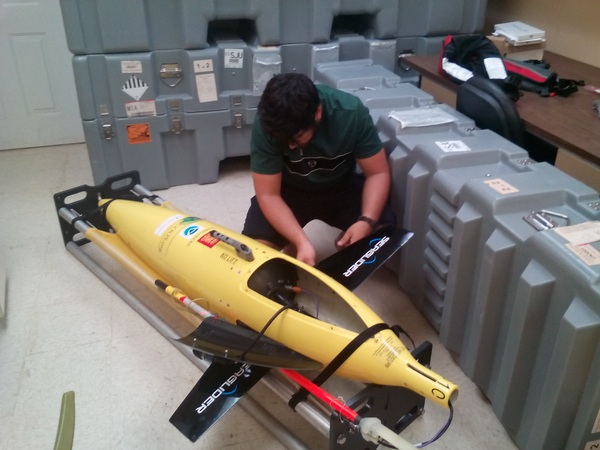 One of the gliders getting a tune up before its next mission. Image credit: NOAA
