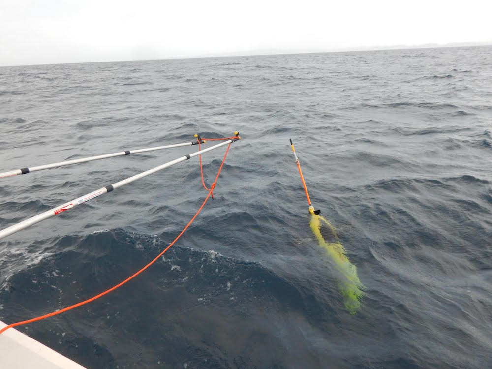 Underwater glider working on being recovered in the Caribbean Sea. Image Credit: NOAA
