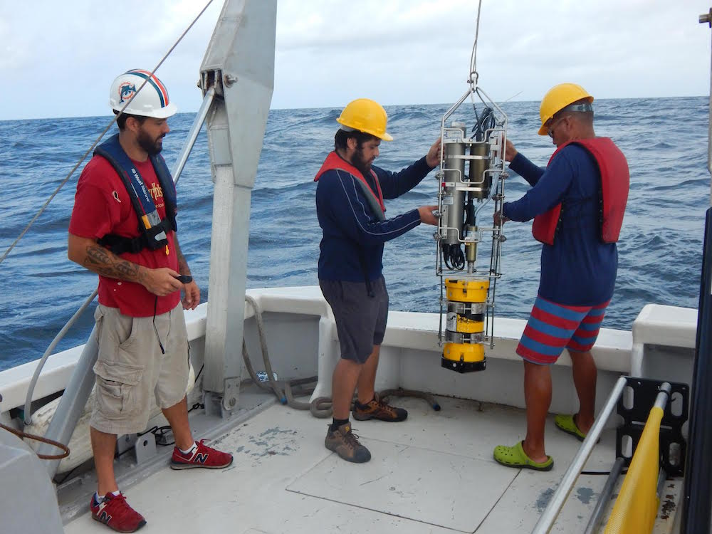 Scientists work to recover the underwater glider in the Caribbean Sea. This mission was concluded on June 2. Image Credit: NOAA