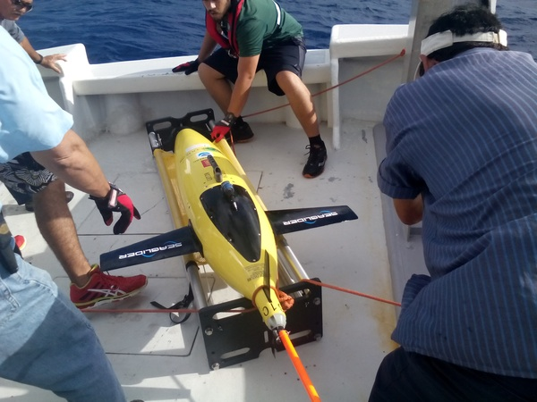 A team of scientists from AOML and the University of Puerto Rico bring one of the gliders aboard the R/V La Sultana.