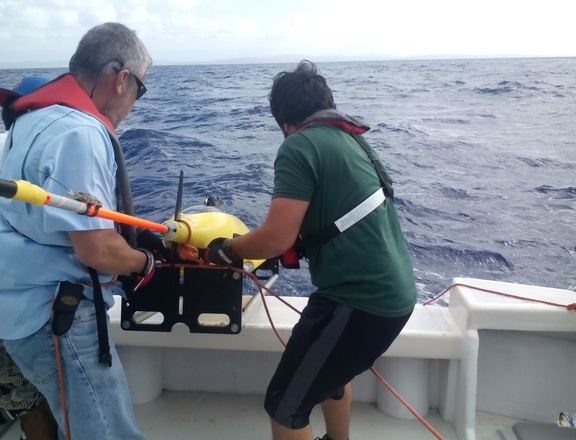 A glider is brought aboard the R/V La Sultana. Image credit: NOAA