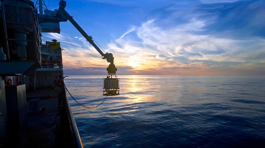 The CTD is deployed as the sun sets in the horizon. Image Credit: NOAA
