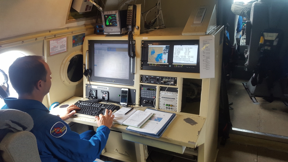 Flight Director Mike Holmes aboard one of four missions into Harvey. Image credit: NOAA