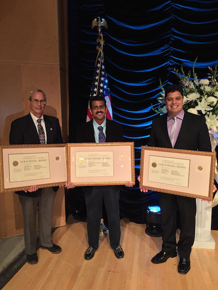 Dr. Frank Marks, Dr. S. G. Gopalakrishnan, and Dr. Thiago Quirino pose with their Department of Commerce Gold Medal Awards. Image credit: NOAA