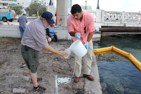 Dr. Chris Sinigalliano cleans out a sampling bottle before taking the final sample. Image credit: NOAA