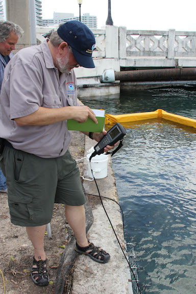 Dr. Chris Sinigalliano takes water quality measurements with a YSI sensor. Image credit: NOAA