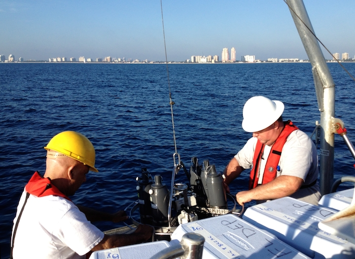 Jack Stamates and Charles Featherstone preparing the CTD (conductivity-temperature-density) instrument for the next cast into the coastal ocean near Miami-Dade. Image credit: NOAA