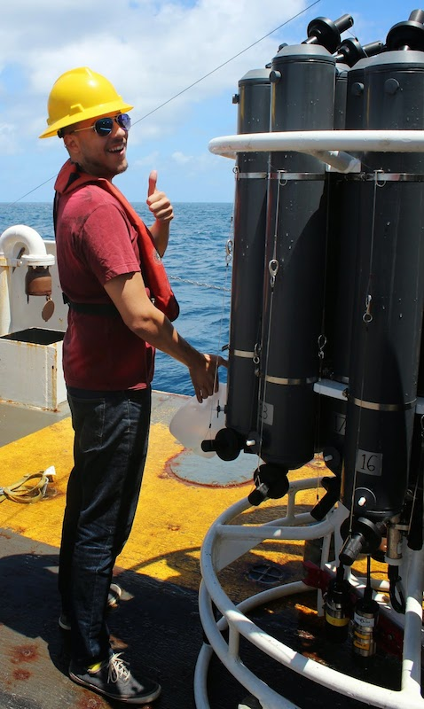 Josué Millán from the University of Puerto Rico collects a water sample from a CTD bottle. Image credit: NOAA