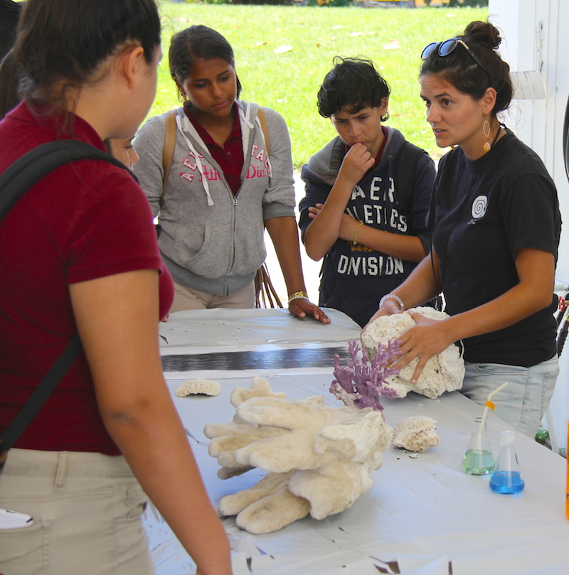 AOML Coral Ecologist discusses ocean acidification impacts on corals with a group of students. Image credit: NOAA