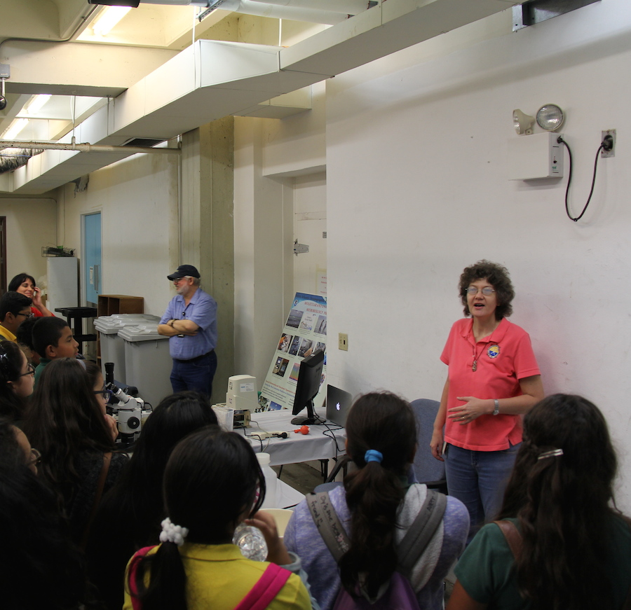 A group of students participate in a environmental microbiology demonstration with AOML scientists. Image credit: NOAA