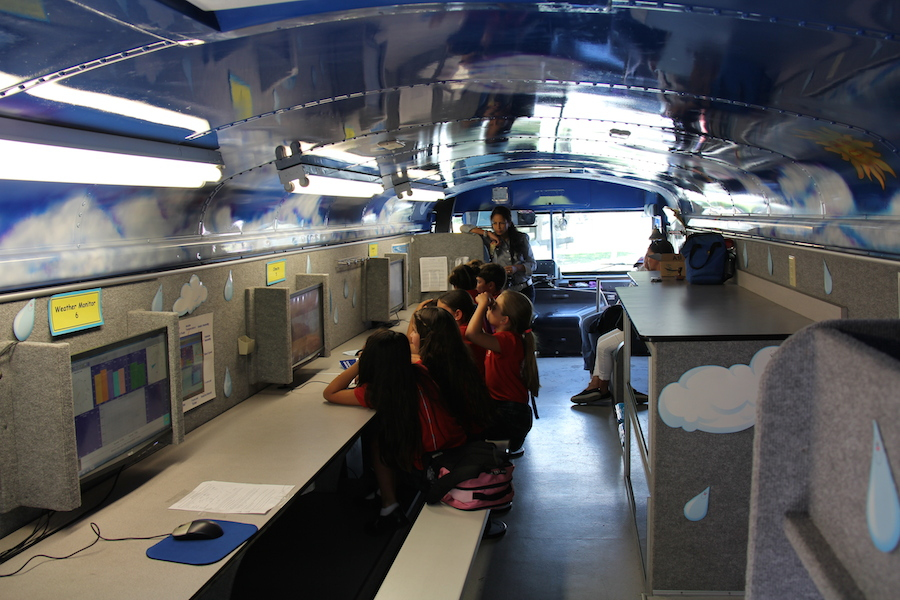 A group of students participate in an activity aboard the MAST LandSharc mobile outreach bus. Image credit: NOAA