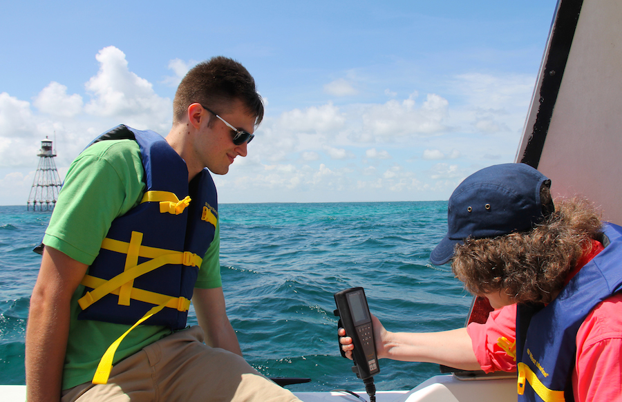 AOML staff and interns take water quality readings on a handheld YSI meter at Tennessee Reef in the Florida Keys National Marine Sanctuary. Image credit: NOAA