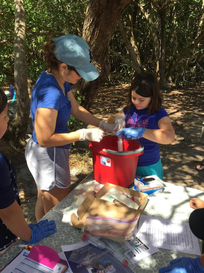 AOML staff assist citizen scientists in collecting a water sample at Matheson Hammock Park in Miami. Image credit: NOAA