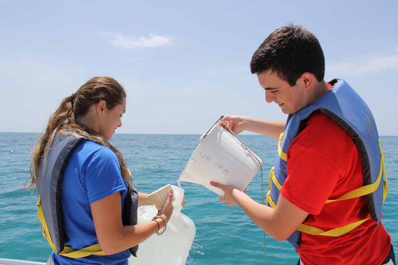AOML interns collect a water sample in the Florida Keys National Marine Sanctuary during the 2014 Ocean Sampling Day event.