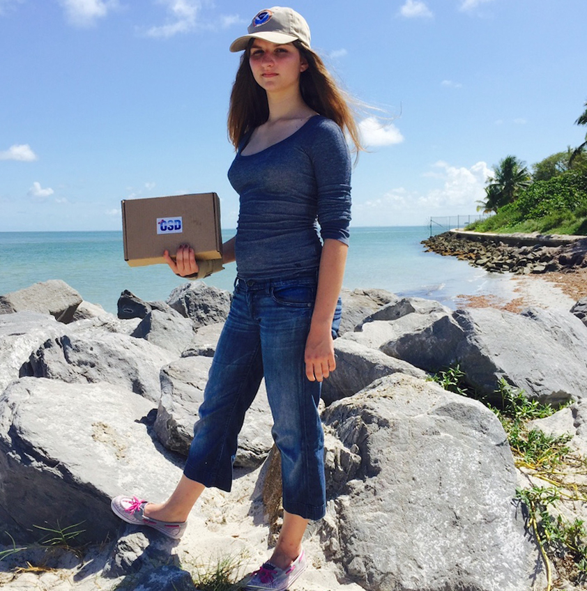 A citizen scientist from MAST Academy samples a site on Key Biscayne with a MyOSD kit.