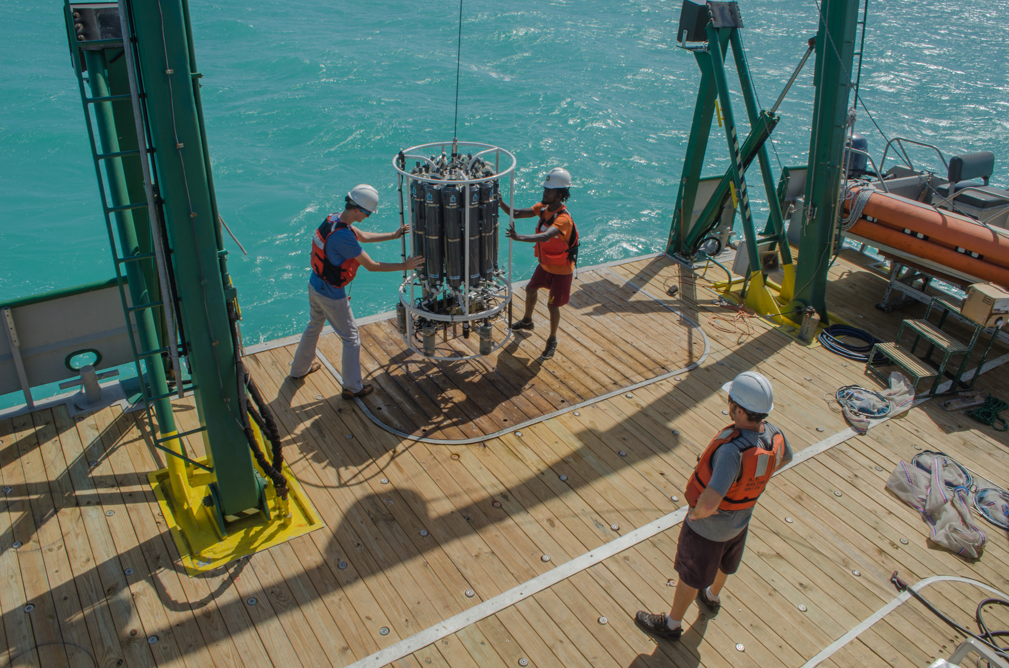 Scientists deploying the CTD. Image credit: NOAA