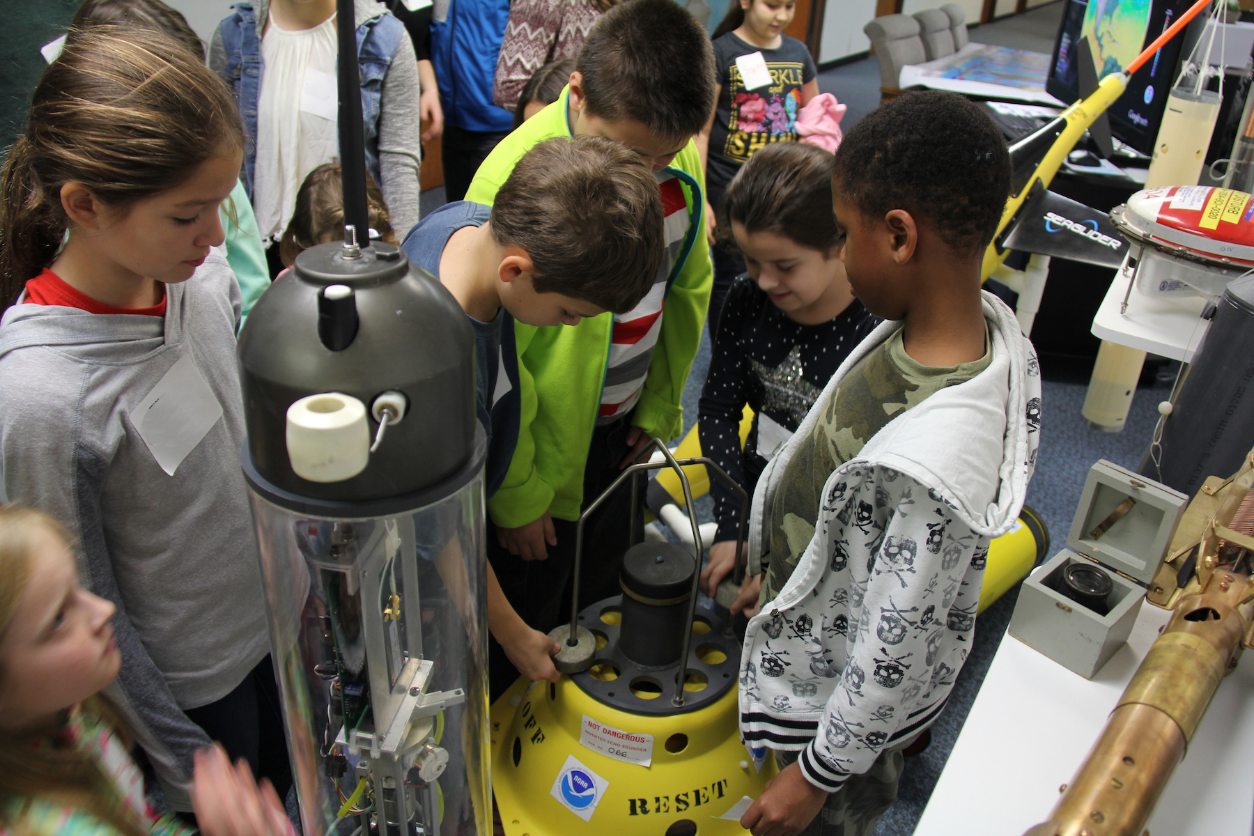Students inspect AOML's array of ocean instruments. Image credit: NOAA