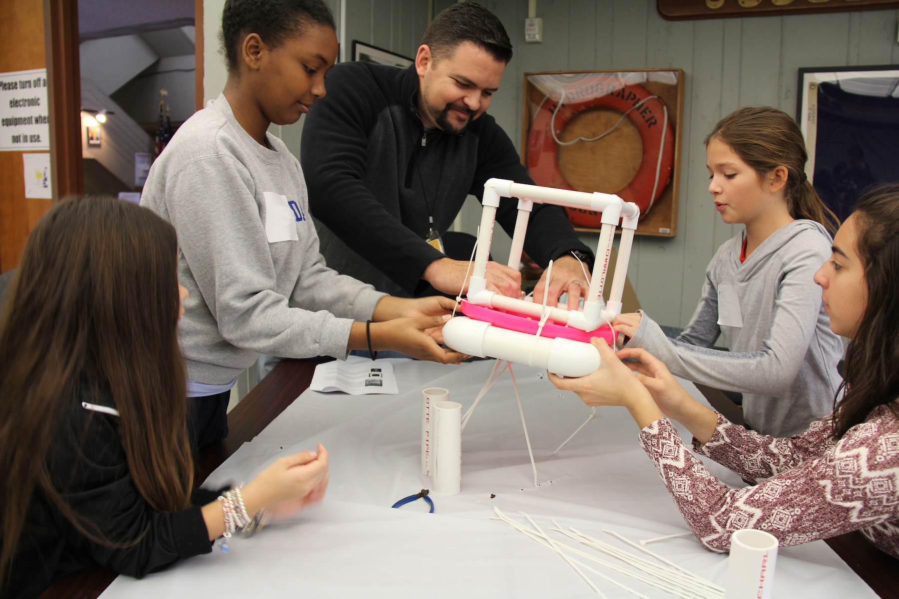 Students work together to construct their own ocean drifters. Image credit: NOAA