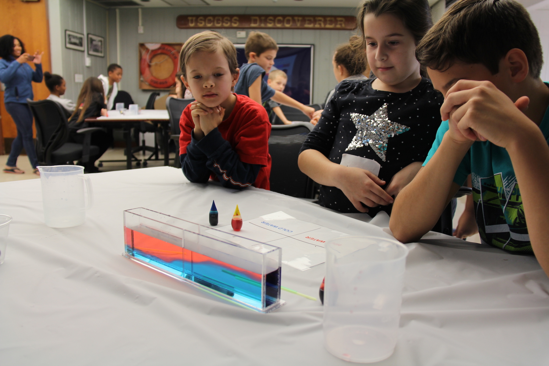 Students participate in a water density demonstration. Image credit: NOAA