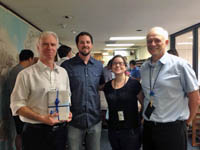 Dr. Atlas (left) celebrates 9 years as the AOML director with AOML scientists. Image credit: NOAA
