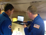 Jason Dunion and Rich Henning discuss the flight plan into Hurricane Edouard. Image credit: NOAA