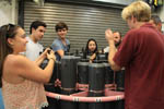 Students examine a CTD rosette to learn how oceanographers collect deep ocean water samples. Image credit: NOAA