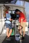 AOML interns prepare a bucket to be used to collect water samples on Ocean Sampling Day 2014. Image credit: NOAA
