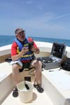 Dr. Chris Sinigalliano tests the water quality with a portable YSI meter. Image credit: NOAA