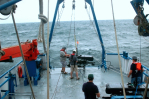 Crew prepares wave glider for deployment. Image credit: NOAA