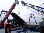 Preparing the wave glider for deployment. Image credit: NOAA