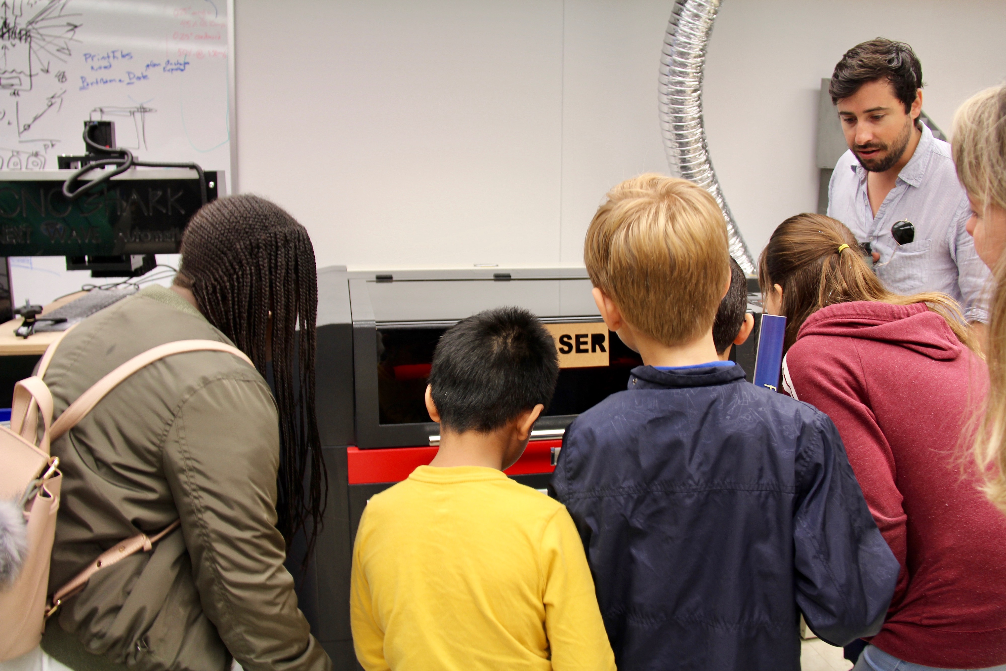 For the first time, the kids were shown the advanced manufacturing lab, where scientists use the laser cutter and 3D printer to customize their lab equipment. Image credit: NOAA
