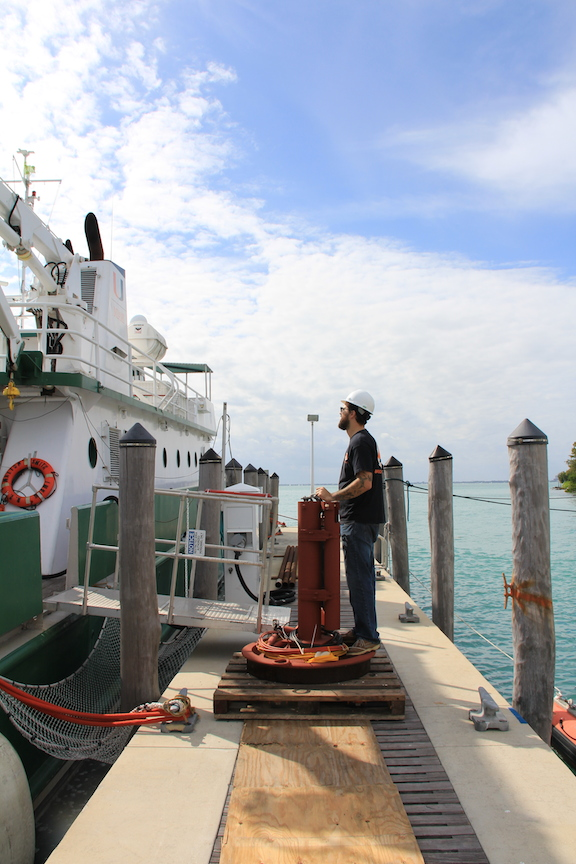 PhOD's Grant Rawson stabilizes the equipment before it is loaded onto the R/V F.G. Walton Smith. Image Credit: NOAA