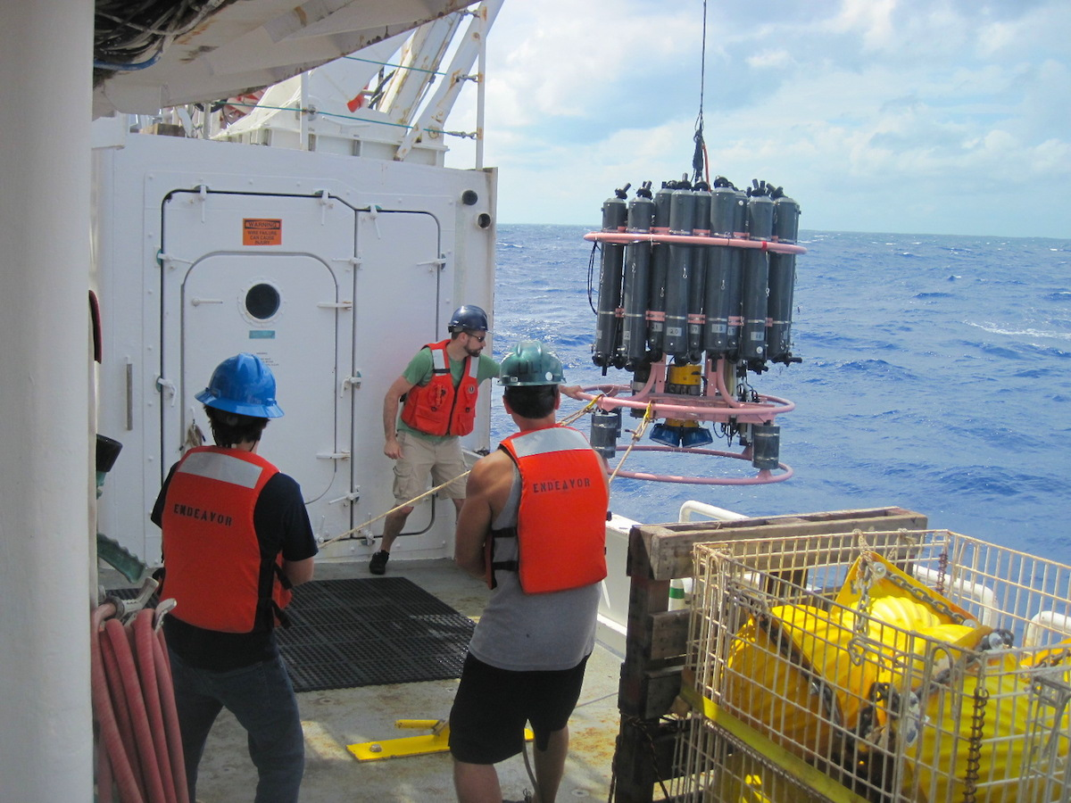 AOML scientists work with members of the ships' crew to recover the CTD package at the end of a 3 hour hydrographic cast. Image credit: NOAA